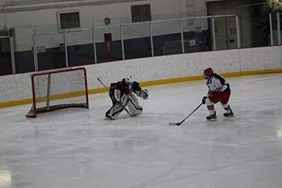 Photography of Laurence playing hockey